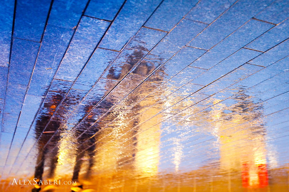 Reflections of Tower bridge on a pavement on London's southbank one evening.