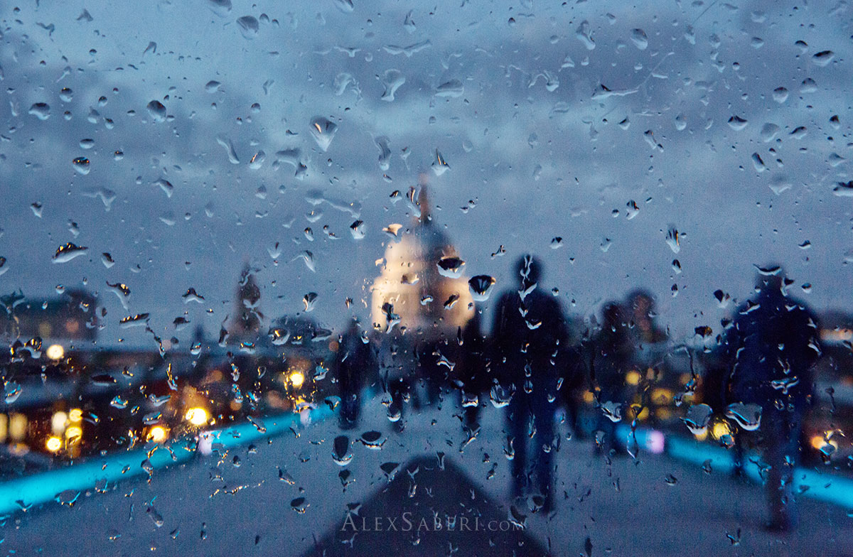 Refractions of St Paul's in the rain though a piece of glass one evening.