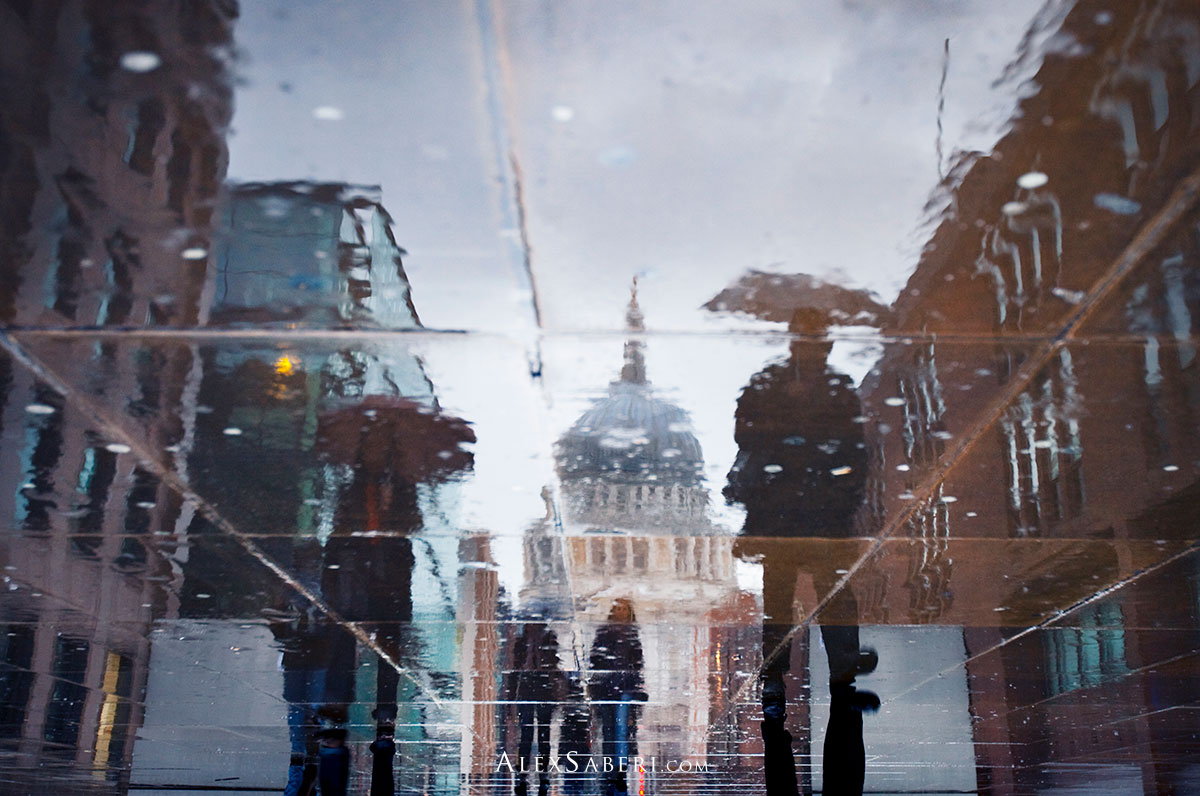 Reflections of St Paul's in the rain on a pavement one evening.