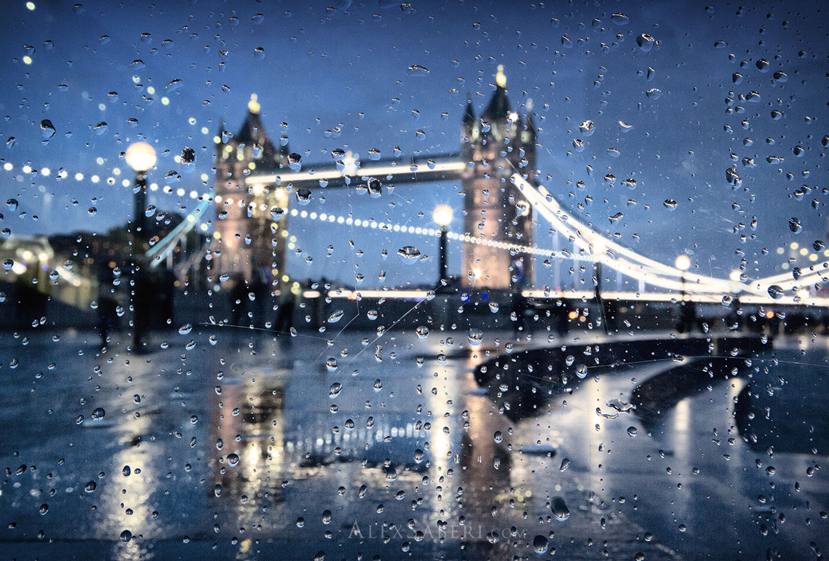 Rain drops on a window with a refracted Tower Bridge.